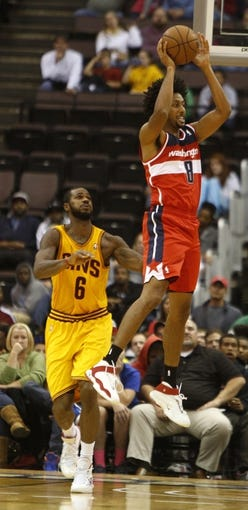 Oct 23, 2013; Cincinnati, OH, USA; Washington Wizards forward Josh Childress (8) rebounds against Cleveland Cavaliers forward Earl Clark (6) in the second half at US Bank Arena. Washington won 101-82. Mandatory Credit: David Kohl-USA TODAY Sports