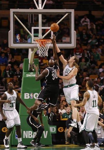 Oct 23, 2013; Boston, MA, USA; Boston Celtics power forward Kelly Olynyk (41) defends against Brooklyn Nets power forward Reggie Evans (30) during the second half at TD Garden. The Celtics defeated the Brooklyn Nets 101-97. Mandatory Credit: David Butler II-USA TODAY Sports