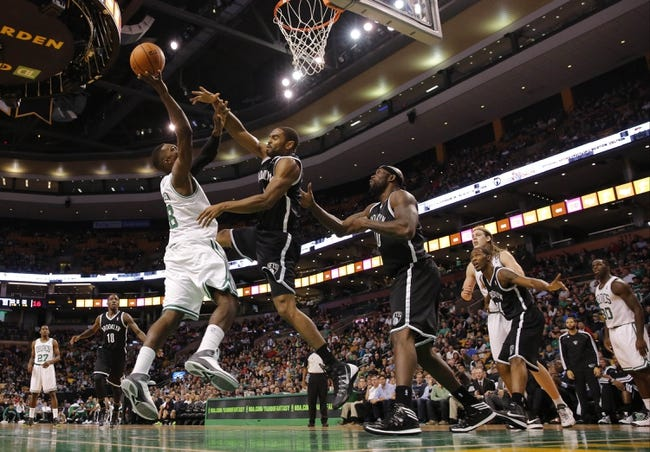 Oct 23, 2013; Boston, MA, USA; Boston Celtics power forward Jeff Green (8) shoots against Brooklyn Nets shooting guard Alan Anderson (6) during the second half at TD Garden. The Celtics defeated the Brooklyn Nets 101-97. Mandatory Credit: David Butler II-USA TODAY Sports