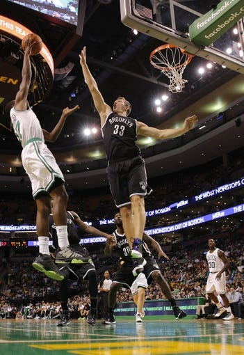 Oct 23, 2013; Boston, MA, USA; Brooklyn Nets power forward Mirza Teletovic (33) defends against Boston Celtics shooting guard Jordan Crawford (27) during the second half at TD Garden. The Celtics defeated the Brooklyn Nets 101-97. Mandatory Credit: David Butler II-USA TODAY Sports
