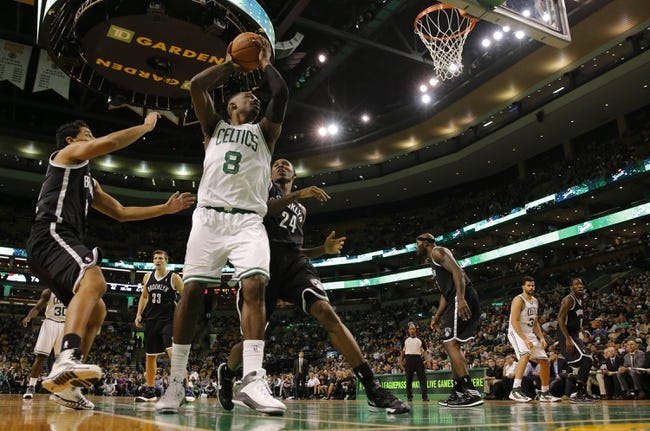 Oct 23, 2013; Boston, MA, USA; Boston Celtics power forward Jeff Green (8) works the ball against Brooklyn Nets small forward Chris Johnson (24) and point guard Jorge Gutierrez (12) during the second half at TD Garden. The Celtics defeated the Brooklyn Nets 101-97. Mandatory Credit: David Butler II-USA TODAY Sports