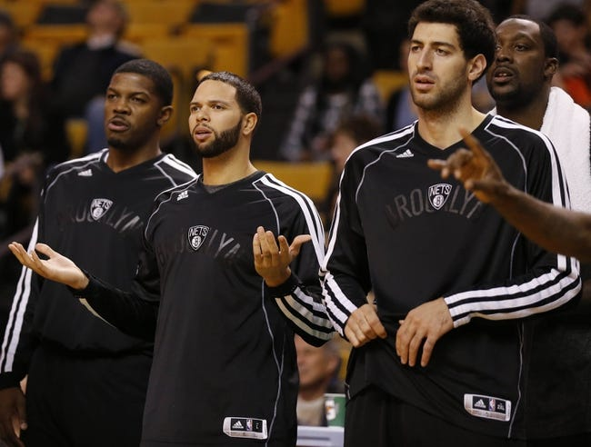 Oct 23, 2013; Boston, MA, USA; Brooklyn Nets point guard Deron Williams (8) (center) reacts after a play as they take on the Boston Celtics during the second half at TD Garden. The Celtics defeated the Brooklyn Nets 101-97. Mandatory Credit: David Butler II-USA TODAY Sports