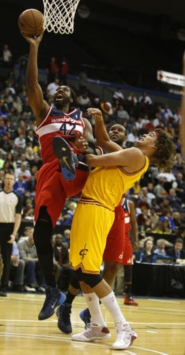 Oct 23, 2013; Cincinnati, OH, USA; Washington Wizards center Nene Hilario (42) goes up for a basket against Cleveland Cavaliers forward Anderson Varejao (17) in the first half at US Bank Arena. Mandatory Credit: David Kohl-USA TODAY Sports