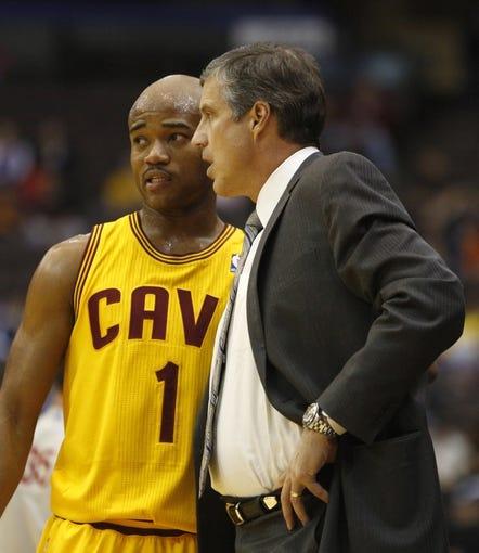 Oct 23, 2013; Cincinnati, OH, USA; Washington Wizards head coach Randy Wittman (right) talks with Cleveland Cavaliers guard Jarrett Jack (1) in the first half at US Bank Arena. Mandatory Credit: David Kohl-USA TODAY Sports