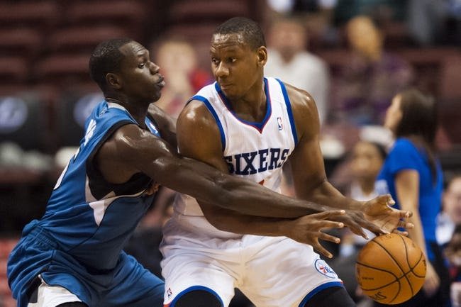 Oct 23, 2013; Philadelphia, PA, USA; Minnesota Timberwolves center Gorgui Dieng (5) knocks the ball away from Philadelphia 76ers forward Lavoy Allen (50) during the fourth quarter at Wells Fargo Center. The Timberwolves defeated the Sixers 125-102. Mandatory Credit: Howard Smith-USA TODAY Sports