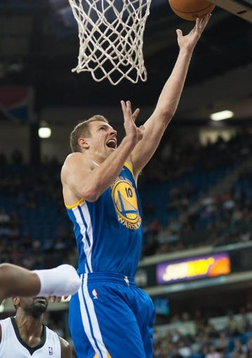 Oct 23, 2013; Sacramento, CA, USA; Golden State Warriors center David Lee (10) attempts a shot during the first quarter against the Sacramento Kings at Sleep Train Arena. Mandatory Credit: Ed Szczepanski-USA TODAY Sports