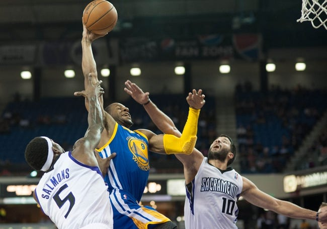 Oct 23, 2013; Sacramento, CA, USA; Golden State Warriors shooting guard Andre Iguodala (9) drives to the basket past Sacramento Kings small forward John Salmons (5) and point guard Greivis Vasquez (10) during the first quarter at Sleep Train Arena. Mandatory Credit: Ed Szczepanski-USA TODAY Sports