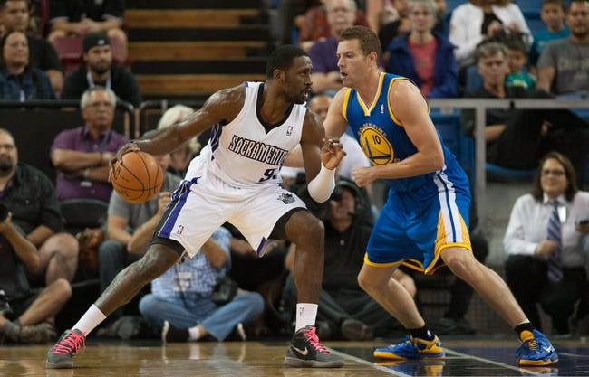 Oct 23, 2013; Sacramento, CA, USA; Sacramento Kings power forward Patrick Patterson (9) moves to the basket on Golden State Warriors center David Lee (10) during the first quarter at Sleep Train Arena. Mandatory Credit: Ed Szczepanski-USA TODAY Sports