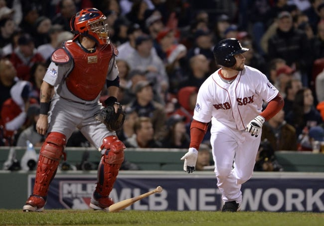 Oct 23, 2013; Boston, MA, USA; Boston Red Sox right fielder Daniel Nava hits a double against the St. Louis Cardinals in the 8th inning during game one of the MLB baseball World Series at Fenway Park. Mandatory Credit: Robert Deutsch-USA TODAY Sports