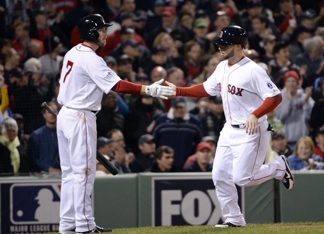 Oct 23, 2013; Boston, MA, USA; Boston Red Sox pinch hitter Daniel Nava (right) is congratulated by shortstop Stephen Drew (not pictured) after scoring a run in the 8th inning against the St. Louis Cardinals during game one of the MLB baseball World Series at Fenway Park. Mandatory Credit: Robert Deutsch-USA TODAY Sports