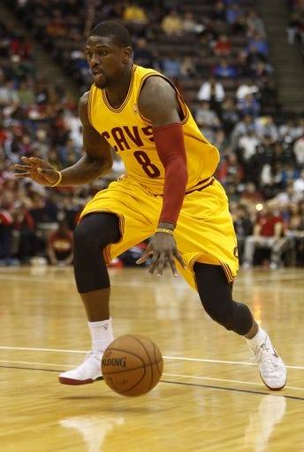 Oct 23, 2013; Cincinnati, OH, USA; Cleveland Cavaliers guard Jermaine Taylor (8) drives to the basket against the Washington Wizards at US Bank Arena. Mandatory Credit: David Kohl-USA TODAY Sports