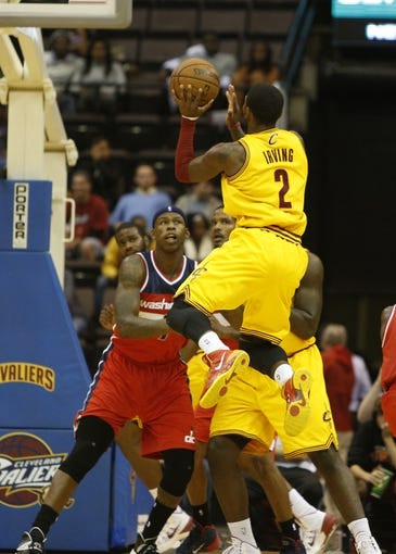 Oct 23, 2013; Cincinnati, OH, USA; Cleveland Cavaliers point guard Kyrie Irving (2) goes up for a basket against the Washington Wizards at US Bank Arena. Mandatory Credit: David Kohl-USA TODAY Sports
