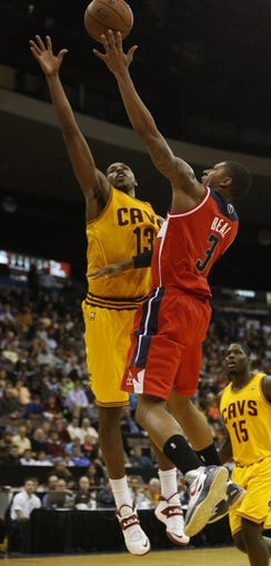 Oct 23, 2013; Cincinnati, OH, USA; Washington Wizards guard Bradley Beal (3) is pressured by Cleveland Cavaliers forward Tristan Thompson (13) at US Bank Arena. Mandatory Credit: David Kohl-USA TODAY Sports