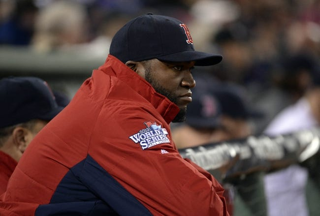 Oct 23, 2013; Boston, MA, USA; Boston Red Sox designated hitter David Ortiz looks out from the dugout in the 9th inning during game one of the MLB baseball World Series against the St. Louis Cardinals at Fenway Park. Mandatory Credit: Robert Deutsch-USA TODAY Sports