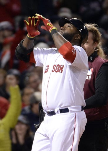 Oct 23, 2013; Boston, MA, USA; Boston Red Sox designated hitter David Ortiz celebrates after hitting a two-run home run against the St. Louis Cardinals during game one of the MLB baseball World Series at Fenway Park. Mandatory Credit: Robert Deutsch-USA TODAY Sports