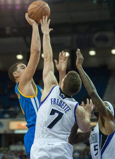 Oct 23, 2013; Sacramento, CA, USA; Golden State Warriors shooting guard Klay Thompson (11) attempts a shot over Sacramento Kings point guard Jimmer Fredette (7) during the second quarter at Sleep Train Arena. Mandatory Credit: Ed Szczepanski-USA TODAY Sports