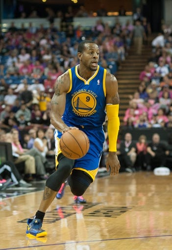 Oct 23, 2013; Sacramento, CA, USA; Golden State Warriors shooting guard Andre Iguodala (9) pushes the ball up the court during the second quarter against the Sacramento Kings at Sleep Train Arena. Mandatory Credit: Ed Szczepanski-USA TODAY Sports