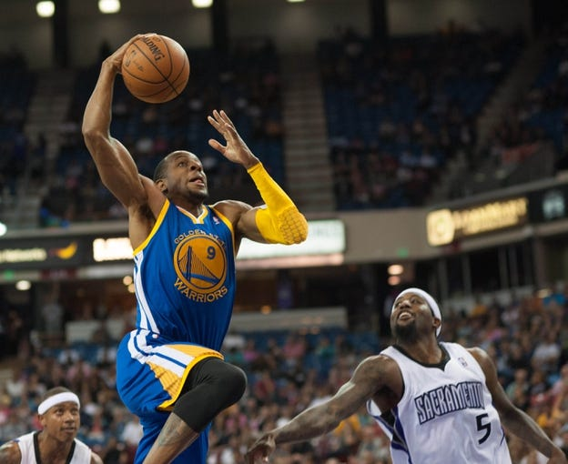 Oct 23, 2013; Sacramento, CA, USA; Golden State Warriors shooting guard Andre Iguodala (9) takes the ball to the basket during the second quarter against the Sacramento Kings at Sleep Train Arena. Mandatory Credit: Ed Szczepanski-USA TODAY Sports