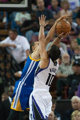 Oct 23, 2013; Sacramento, CA, USA; Golden State Warriors point guard Stephen Curry (30) blocks a shot by Sacramento Kings point guard Greivis Vasquez (10) during the second quarter at Sleep Train Arena. Mandatory Credit: Ed Szczepanski-USA TODAY Sports