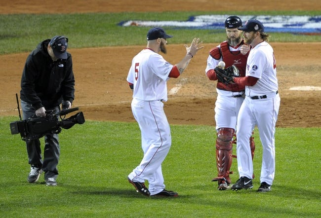 Oct 23, 2013; Boston, MA, USA; Boston Red Sox players Jonny Gomes (5) , David Ross (middle) and Ryan Dempster celebrate after game one of the MLB baseball World Series against the St. Louis Cardinals at Fenway Park. Mandatory Credit: Bob DeChiara-USA TODAY Sports
