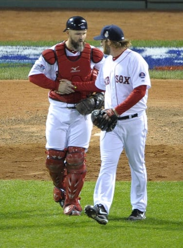Oct 23, 2013; Boston, MA, USA; Boston Red Sox starting pitcher Ryan Dempster (right) celebrates with catcher David Ross after game one of the MLB baseball World Series against the St. Louis Cardinals at Fenway Park. Mandatory Credit: Bob DeChiara-USA TODAY Sports
