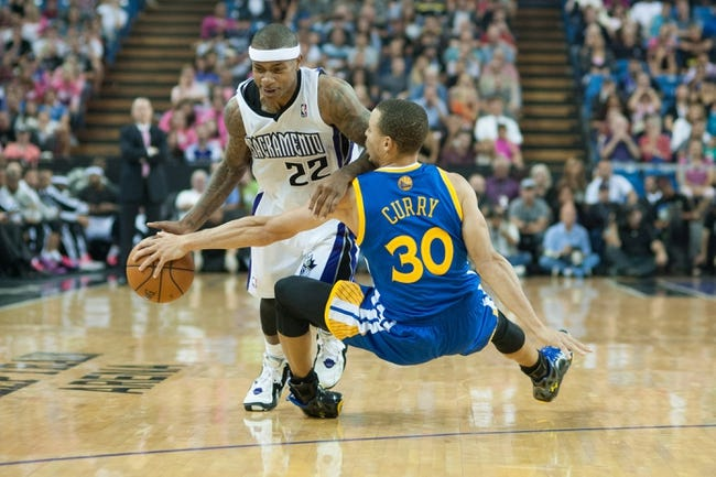 Oct 23, 2013; Sacramento, CA, USA; Golden State Warriors point guard Stephen Curry (30) attempts to steal the ball from Sacramento Kings point guard Isaiah Thomas (22) during the fourth quarter at Sleep Train Arena. The Sacramento Kings defeated the Golden State Warriors 91-90. Mandatory Credit: Ed Szczepanski-USA TODAY Sports