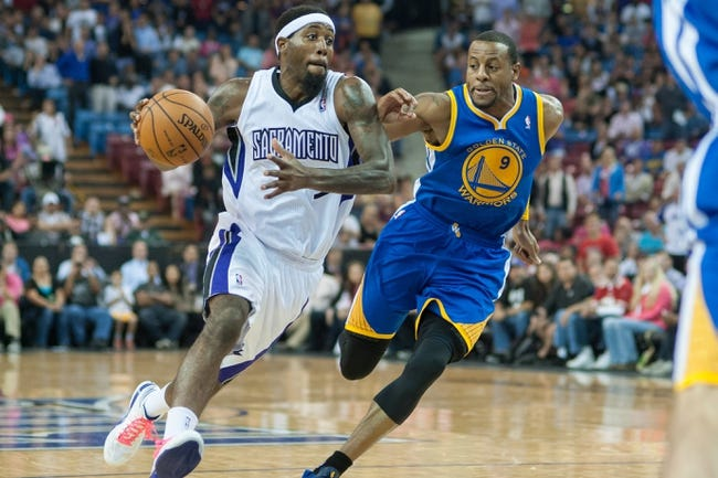 Oct 23, 2013; Sacramento, CA, USA; Sacramento Kings small forward John Salmons (5) drives to the basket during the fourth quarter against Golden State Warriors shooting guard Andre Iguodala (9) at Sleep Train Arena. The Sacramento Kings defeated the Golden State Warriors 91-90. Mandatory Credit: Ed Szczepanski-USA TODAY Sports