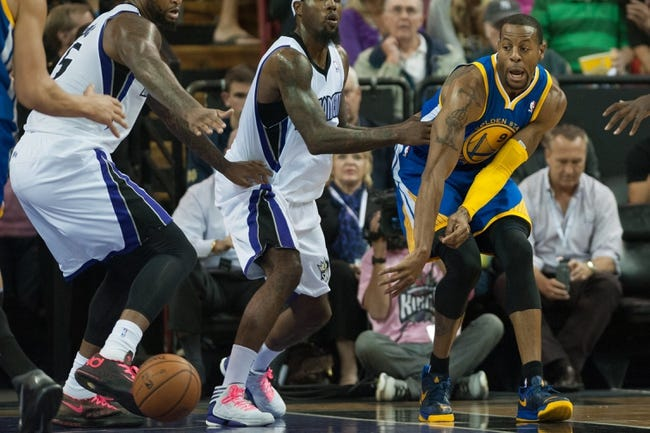 Oct 23, 2013; Sacramento, CA, USA; Golden State Warriors shooting guard Andre Iguodala (9) passes the ball across the key during the fourth quarter of the game against the Sacramento Kings at Sleep Train Arena. The Sacramento Kings defeated the Golden State Warriors 91-90. Mandatory Credit: Ed Szczepanski-USA TODAY Sports
