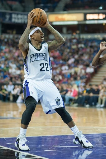 Oct 23, 2013; Sacramento, CA, USA; Sacramento Kings point guard Isaiah Thomas (22) pulls up for a shot during the fourth quarter of the game against the Golden State Warriors at Sleep Train Arena. The Sacramento Kings defeated the Golden State Warriors 91-90. Mandatory Credit: Ed Szczepanski-USA TODAY Sports