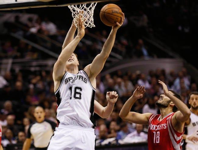 Oct 24, 2013; San Antonio, TX, USA; San Antonio Spurs forward Aron Baynes (16) shoots against the Houston Rockets during the first half at AT&T Center. Mandatory Credit: Soobum Im-USA TODAY Sports