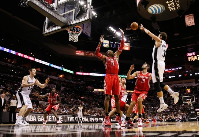Oct 24, 2013; San Antonio, TX, USA; San Antonio Spurs forward Marco Belinelli (3) passes the ball over Houston Rockets center Dwight Howard (12) during the first half at AT&T Center. Mandatory Credit: Soobum Im-USA TODAY Sports