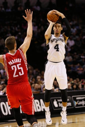 Oct 24, 2013; San Antonio, TX, USA; San Antonio Spurs guard Danny Green (4) shoots against Houston Rockets forward Chandler Parsons (25) during the first half at AT&T Center. Mandatory Credit: Soobum Im-USA TODAY Sports
