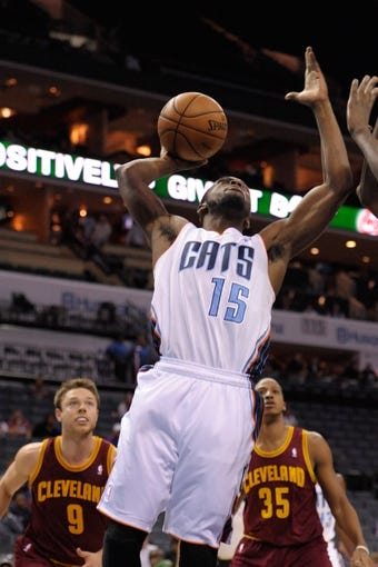 Oct 24, 2013; Charlotte, NC, USA; Charlotte Bobcats guard Kemba Walker (15) drives to the basket and scores during the game against the Cleveland Cavaliers at Time Warner Cable Arena. The Bobcats won 102-95. Mandatory Credit: Sam Sharpe-USA TODAY Sports