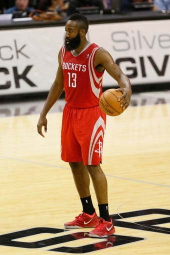 Oct 24, 2013; San Antonio, TX, USA; Houston Rockets guard James Harden (13) controls the ball during the second half against the San Antonio Spurs at AT&T Center. Mandatory Credit: Soobum Im-USA TODAY Sports