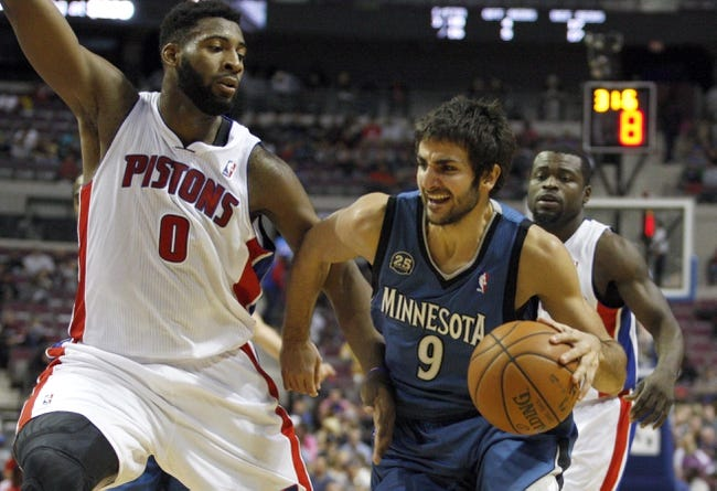 Oct 24, 2013; Auburn Hills, MI, USA; Minnesota Timberwolves point guard Ricky Rubio (9) gets defended by Detroit Pistons center Andre Drummond (0) during the second quarter at The Palace of Auburn Hills. Mandatory Credit: Raj Mehta-USA TODAY Sports