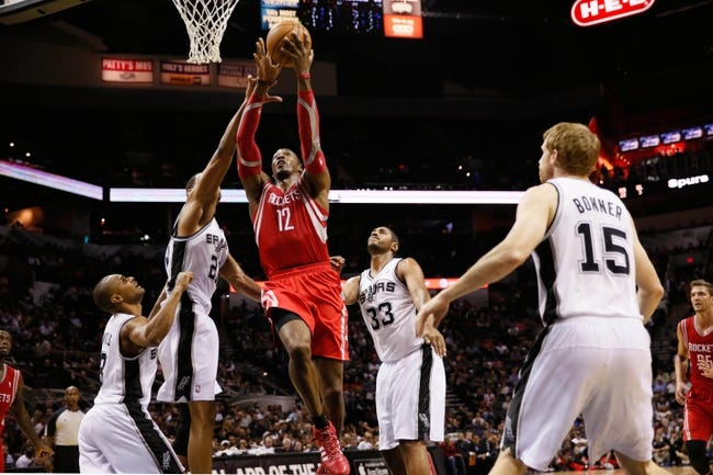 Oct 24, 2013; San Antonio, TX, USA; Houston Rockets center Dwight Howard (12) drives to the basket as San Antonio Spurs forward Tim Duncan (left)  defends during the second half at AT&T Center. The Rockets won 109-92. Mandatory Credit: Soobum Im-USA TODAY Sports