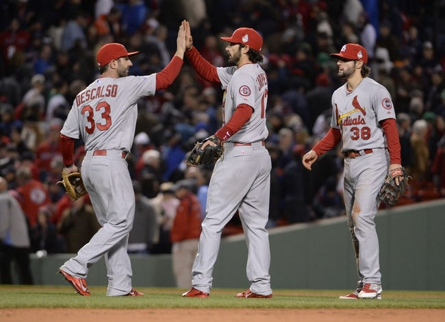 Oct 24, 2013; Boston, MA, USA; St. Louis Cardinals players Daniel Descalso (33) , Matt Carpenter (13) and Pete Kozma (38) celebrate on the field after game two of the MLB baseball World Series against the Boston Red Sox at Fenway Park. Mandatory Credit: Robert Deutsch-USA TODAY Sports