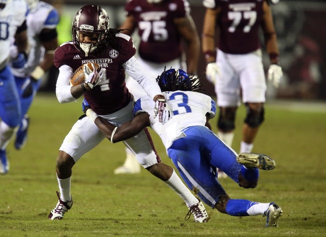 Oct 24, 2013; Starkville, MS, USA; Mississippi State Bulldogs wide receiver Jameon Lewis (4) attempts to break a tackle by Kentucky Wildcats cornerback Fred Tiller (3) during the game at Davis Wade Stadium. Mississippi State Bulldogs win the game against Kentucky Wildcats 28-22.  Mandatory Credit: Spruce Derden-USA TODAY Sports