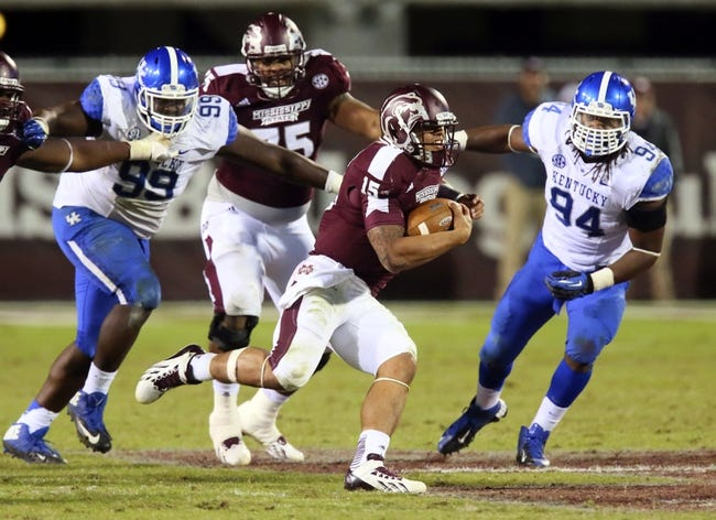 Oct 24, 2013; Starkville, MS, USA; Mississippi State Bulldogs quarterback Dak Prescott (15) advances the ball during the game against the Kentucky Wildcats at Davis Wade Stadium. Mississippi State Bulldogs win the game against Kentucky Wildcats 28-22.  Mandatory Credit: Spruce Derden-USA TODAY Sports