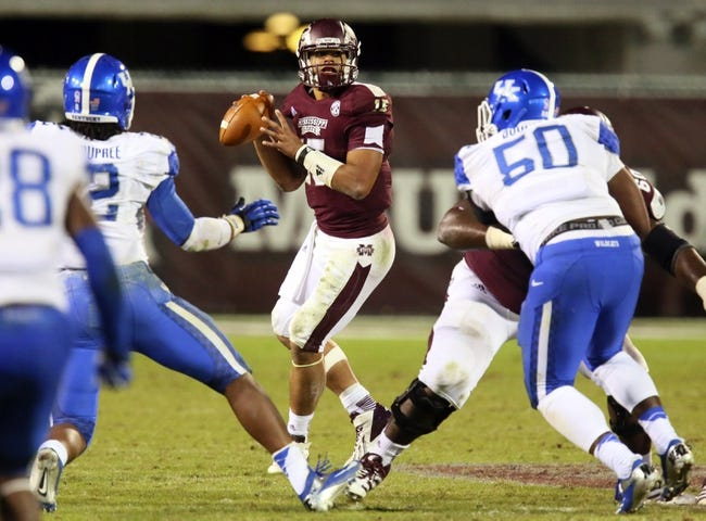 Oct 24, 2013; Starkville, MS, USA; Mississippi State Bulldogs quarterback Dak Prescott (15) drops back for a pass the ball during the game against the Kentucky Wildcats at Davis Wade Stadium. Mississippi State Bulldogs win the game against Kentucky Wildcats 28-22.  Mandatory Credit: Spruce Derden-USA TODAY Sports
