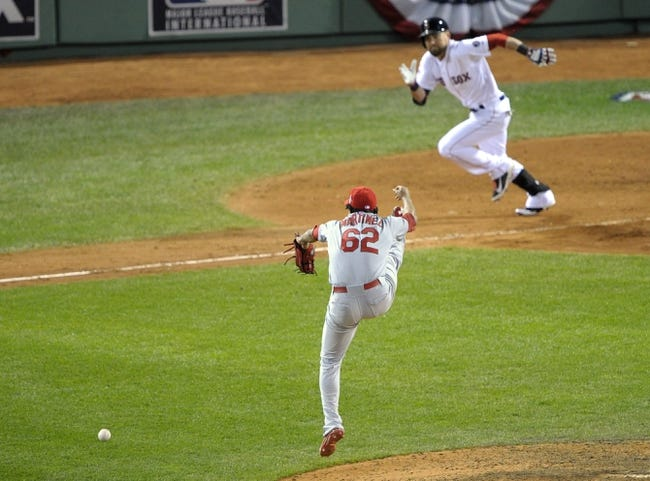 Oct 24, 2013; Boston, MA, USA; St. Louis Cardinals relief pitcher Carlos Martinez (62) is unable to field a ball hit by Boston Red Sox center fielder Jacoby Ellsbury in the 8th inning during game two of the MLB baseball World Series at Fenway Park. Mandatory Credit: Bob DeChiara-USA TODAY Sports