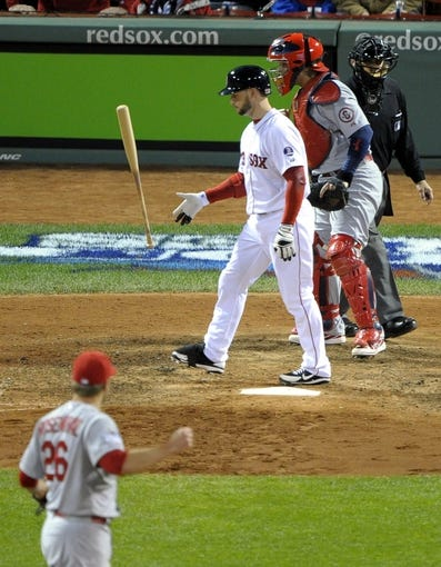 Oct 24, 2013; Boston, MA, USA; Boston Red Sox pinch hitter Daniel Nava (middle) reacts after striking out to St. Louis Cardinals relief pitcher Trevor Rosenthal (26) for the final out of game two of the MLB baseball World Series at Fenway Park. Mandatory Credit: Bob DeChiara-USA TODAY Sports