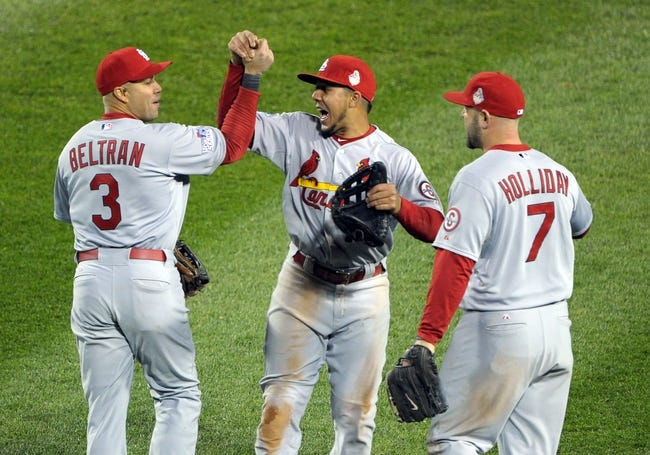 Oct 24, 2013; Boston, MA, USA; St. Louis Cardinals outfielders Carlos Beltran (3) , Jon Jay (19) and Matt Holliday (7) celebrate after game two of the MLB baseball World Series against the Boston Red Sox at Fenway Park. Mandatory Credit: Bob DeChiara-USA TODAY Sports