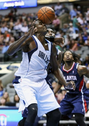 Oct 23, 2013; Dallas, TX, USA; Dallas Mavericks center Samuel Dalembert (1) gets hit in the face by the ball during the game against the Atlanta Hawks at American Airlines Center. Dallas won 99-88. Mandatory Credit: Kevin Jairaj-USA TODAY Sports