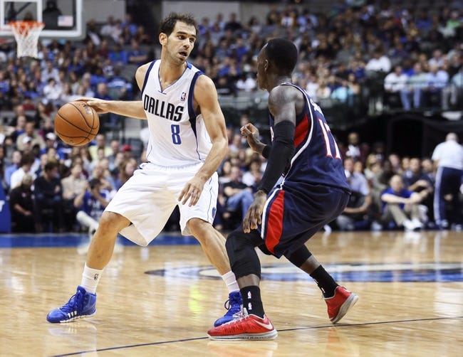 Oct 23, 2013; Dallas, TX, USA; Dallas Mavericks point guard Jose Calderon (8) dribbles as Atlanta Hawks point guard Dennis Schroder (17) defends during the game at American Airlines Center. Dallas won 99-88. Mandatory Credit: Kevin Jairaj-USA TODAY Sports