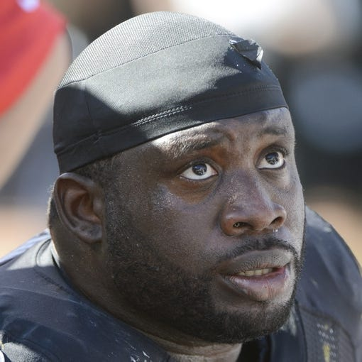 September 29, 2013; Oakland, CA, USA; Oakland Raiders guard Andre Gurode (64) sits on the bench during the third quarter against the Washington Redskins at O.co Coliseum. The Redskins defeated the Raiders 24-14. Mandatory Credit: Kyle Terada-USA TODAY Sports