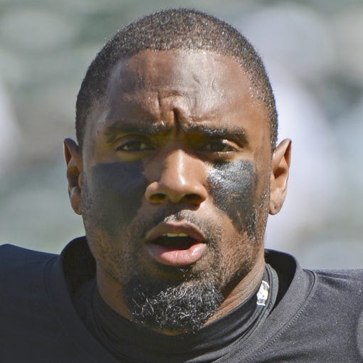 September 29, 2013; Oakland, CA, USA; Oakland Raiders free safety Charles Woodson (24) warms up before the game against the Washington Redskins at O.co Coliseum. The Redskins defeated the Raiders 24-14. Mandatory Credit: Kyle Terada-USA TODAY Sports