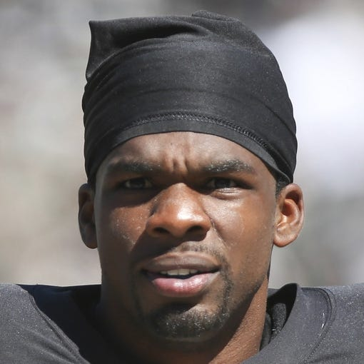 Sep 15, 2013; Oakland, CA, USA; Oakland Raiders cornerback Tracy Porter (23) on the sideline against the Jacksonville Jaguars during the second quarter at O.co Coliseum. Mandatory Credit: Kelley L Cox-USA TODAY Sports
