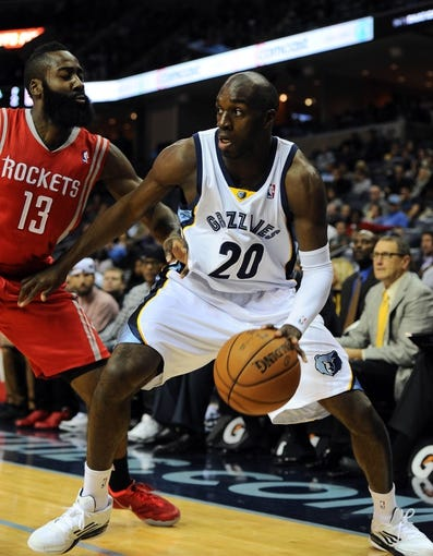 Oct 25, 2013; Memphis, TN, USA; Memphis Grizzlies small forward Quincy Pondexter (20) handles the ball against Houston Rockets shooting guard James Harden (13) during the first quarter at FedExForum. Mandatory Credit: Justin Ford-USA TODAY Sports