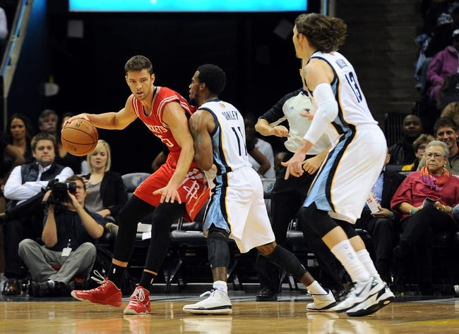 Oct 25, 2013; Memphis, TN, USA; Houston Rockets small forward Chandler Parsons (25) handles the ball against Memphis Grizzlies point guard Mike Conley (11) during the first quarter at FedExForum. Mandatory Credit: Justin Ford-USA TODAY Sports